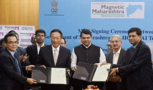 Maharashtra CM Devendra Fadnavis and Foxconn chairman Terry Gou at the signing of an MoU, in Mumbai